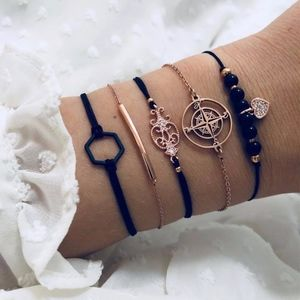 'My Guide' Compass Gold and Black 5 Piece Bracelet